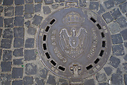 The coat of arms of Bucharest, Romania on a manhole cover