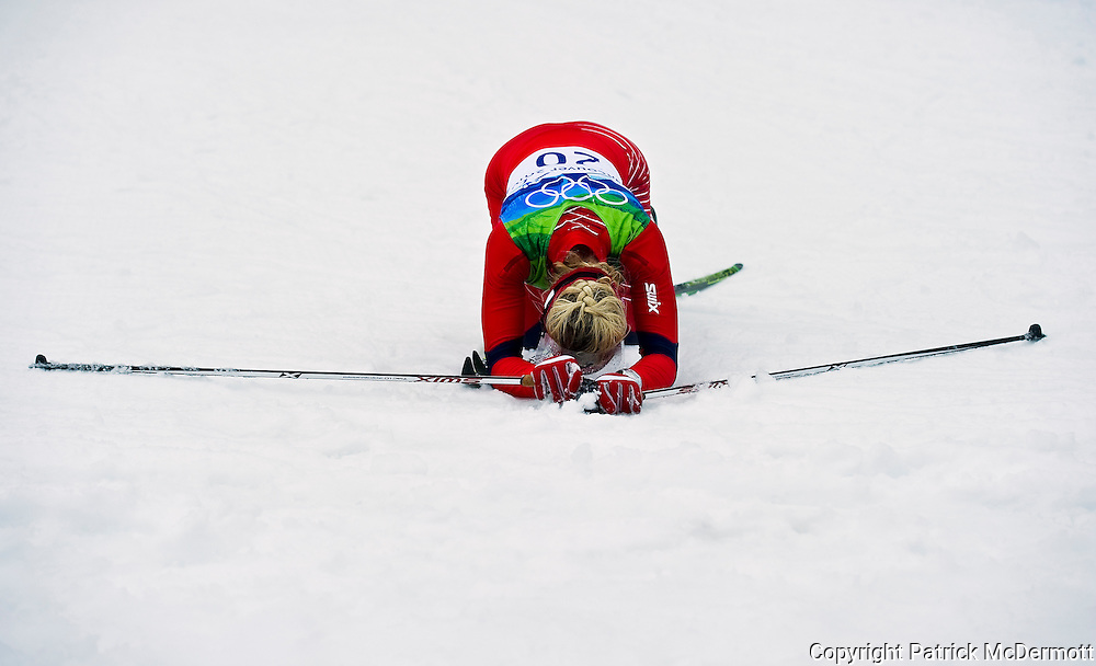 Therese Johaug of Norway reacts after crossing the finish line during the ladies' 30 km mass start cross-country skiing classic on day 16 of the 2010 Vancouver Winter Olympics at Whistler Olympic Park Cross-Country Stadium in Whistler, Canada on February 27, 2010.
