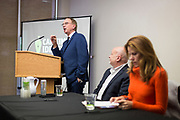 John Nichols, left, introduces the panel participants during the Cap Times Idea Fest 2018 at the Pyle Center in Madison, Wisconsin, Saturday, Sept. 29, 2018.