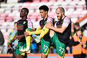 Teemu Pukki (22), Jamal Lewis (12) and Ibrahim Amadou (24) of Norwich City warming up ahead of the Premier League match between Bournemouth and Norwich City at the Vitality Stadium, Bournemouth, England on 19 October 2019.