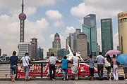 People watch Huangpu River activity along the Bund Shanghai, China