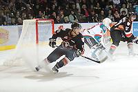 KELOWNA, CANADA, FEBRUARY 17: Chase Clayton #15 of the Calgary Hitmen stops on the ice at the Kelowna Rockets on February 17, 2012 at Prospera Place in Kelowna, British Columbia, Canada (Photo by Marissa Baecker/Shoot the Breeze) *** Local Caption ***