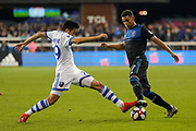 March 2, 2019; San Jose, CA, USA; Montreal Impact midfielder Mathieu Choiniere (29) and San Jose Earthquakes defender Marcos Lopez (27) fight for the ball during the second half at Avaya Stadium.