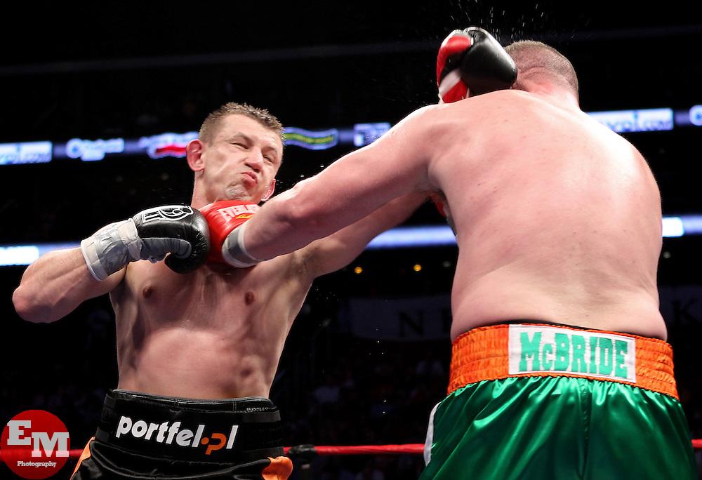 April 9, 2011; Newark, NJ; USA; Tomasz Adamek (Black/Orange) and Kevin McBride (Green/White) during their 12 round heavyweight bout at the Prudential Center in Newark, NJ.  Adamek won via 12 round unanimous decision.
