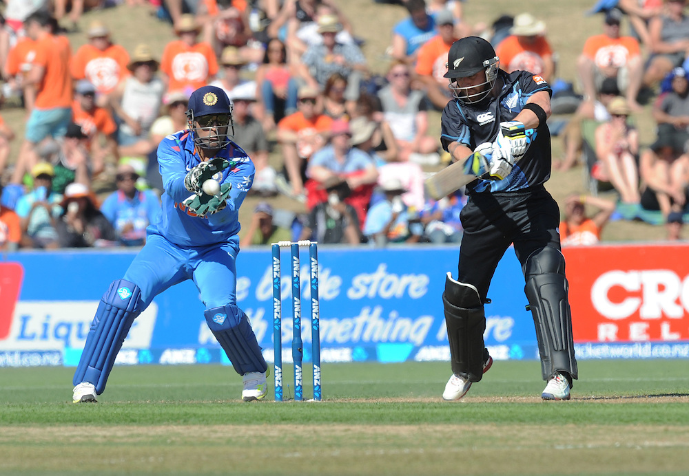 India's MS Dhoni, left, takes the catch to dismiss New Zealand's Brendon McCullum for 30 off the bowling of India's Mohammed Shami in the first one day International cricket match, McLean Park, New Zealand, Sunday, January 19, 2014. Credit:SNPA / Ross Setford