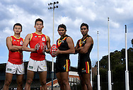 Players from Aussie rules Team China and the Port Power indigenous Academy. L to R Shaoliang Chen, Hao Zhang,   Anthony Stengles and  Kym Lebois.