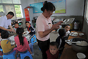 QIANNAN, CHINA - MAY 31: (CHINA OUT) <br /> <br /> Six-pupil School In Mountain Of Qiannan<br /> <br /> Pupils have lunch at Gugang primary school in a mountain in Longli County on May 31, 2016 in Qiannan Buyei and Miao Autonomous Prefecture, Guizhou Province of China. Gugang primary school with only one teacher and six students was located in the mountain where the traffic was blocked in Qiannan. 50-year-old Wu Guoxian had been teaching in this school for 33 years and taught over 1,000 students. More and more people went out of the village to work in the cities leaving their children and the old in the mountain. Five under-school-age kids whose parents left for work also stayed at the school.<br /> ©Exclusivepix Media