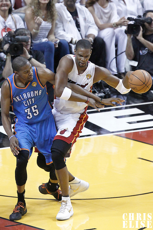 17 June 2012: Oklahoma City Thunder small forward Kevin Durant (35) defends on Miami Heat power forward Chris Bosh (1) during the Miami Heat 91-85 victory over the Oklahoma City Thunder, in Game 3 of the 2012 NBA Finals, at the AmericanAirlinesArena, Miami, Florida, USA.