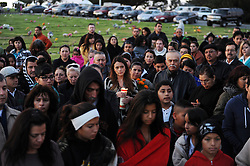 Families listen to Bible readings during a candlelight procession that began at dusk. In a touching final celebration of All Soul's Day on Saturday night, hundreds of congregants came to Queen of Heaven Cemetery in Salinas to attend mass and offer their prayers. Friends and family members sat by the graves of loved ones, many of which were decorated with traditional Day of the Dead marigolds, photographs of the departed, and things that were their favorites in life.