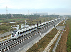 "File photo taken on Dec. 29, 2015 shows a bullet train running on the western part of a loop line of Hainan high-speed railway in south China's island of Hainan Province. ""Building more high-speed railways"" has been a hot topic at the annual sessions of China's provincial legislatures and political advisory bodies intensively held in January. China has the world's largest high-speed rail network, with the total operating length reaching 19,000 km by the end of 2015, about 60 percent of the world's total. The expanding high-speed rail network is offering unprecedented convenience and comfort to travelers, and boosting local development as well. Chinese companies have developed world-leading capabilities in building high-speed railways in extreme natural conditions. High-speed railway routes across China have been designed to suit its varying climate and geographical conditions. The Harbin-Dalian high-speed railway travels through areas where the temperature drops to as low as 40 degree Celsius below zero in winter, the Lanzhou-Xinjiang railway passes through the savage Gobi Desert and the Hainan Island railway can withstand a battering from typhoons. The China Railway Corp. plans to spend another 800 billion yuan (around 120 billion U.S. dollars) in 2016, especially in less-developed central and western regions. EXPA Pictures © 2016, PhotoCredit: EXPA/ Photoshot/ Xing Guangli<br />