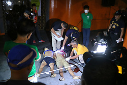 October 4, 2016 - Philippines - (EDITOR'S NOTE: Image contains graphic content) Members of S.O.C.O. (Scene of the Crime Operatives) process the crime scene and the remain of two un-identified allegedly drug dealers are the victims of summary executions at the front of Santa Catalina Colleges, Legarda, Manila City. (Credit Image: © Gregorio B. Dantes Jr/Pacific Press via ZUMA Wire)