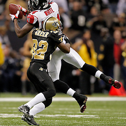 2009 November 02: Atlanta Falcons wide receiver Roddy White (84) catches a pass in front of New Orleans Saints cornerback Jabari Greer (32) during the first half at the Louisiana Superdome in New Orleans, Louisiana.