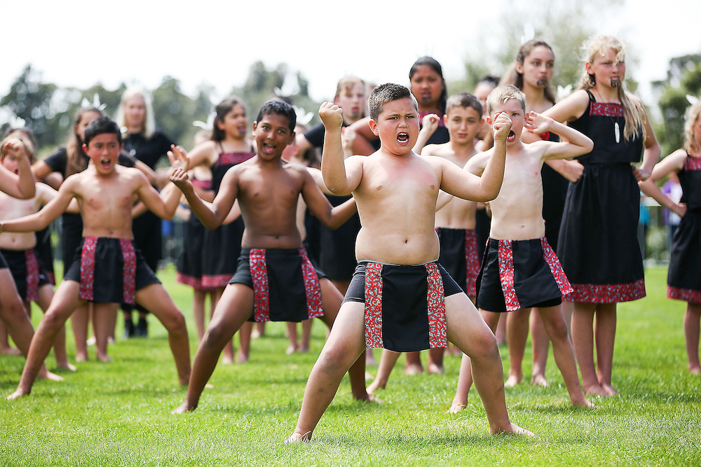 Children perform a haka for Prince Charles, Prince of Wales and Camilla, Duchess of Cornwall during the 'Tea With Taranaki' event at Brooklands Park, New Plymouth, New Zealand, New Zealand, Monday, November 09, 2015. Credit:SNPA / Getty, Hagen Hopkins  **POOL**