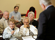 Esther Nason of Kingston, at left with microphone, asks Rep. Maurice Hinchey a question after he talked to senior citizens about improvements in health care coverage at the Rosendale Recreation Center on Tuesday, March 30, 2010.