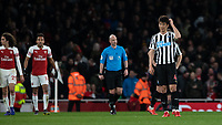 Football - 2018 / 2019 Premier League - Arsenal vs. Newcastle United<br /> <br /> Ki Sung Yueng (Newcastle United)  scratches his head in puzzlement after Arsenal score their second goal at The Emirates.<br /> <br /> COLORSPORT/DANIEL BEARHAM