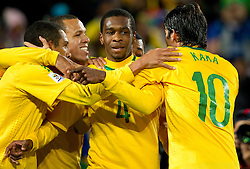 Players of Brazil celebrate after Juan (C) scored during the 2010 FIFA World Cup South Africa Round of Sixteen match between Brazil and Chile at Ellis Park Stadium on June 28, 2010 in Johannesburg, South Africa.  (Photo by Vid Ponikvar / Sportida)