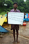 K Mallappa - 27 yrs.Hindu.Mangalore, Karnataka .Migrant manual laborer. .Kannada - 'Without an education I am doing the work of a manual laborer, but I am happy. Though I would be more happy if I was a bird or an animal.'