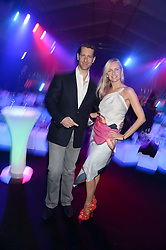 MARLON ABELA and NADYA ABELA at a party to celebrate the 1st birthday of nightclub 2&8 at Mortons held in Berkeley Square, London on 3rd October 2013.