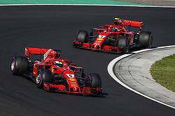 July 29, 2018 - Budapest, Hungary - Motorsports: FIA Formula One World Championship 2018, Grand Prix of Hungary, .#5 Sebastian Vettel (GER, Scuderia Ferrari), #7 Kimi Raikkonen (FIN, Scuderia Ferrari) (Credit Image: © Hoch Zwei via ZUMA Wire)