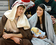 FRANCONIA, PA - DECEMBER 23: Adam Bahl, 18 and Kelly Bergen, 18, both of Perkasie, Pennsylvania sit in the stands dressed as Joseph and Mary with baby Jesus at halftime of the Pennridge versus Souderton game December 23, 2014 at Souderton High School in Franconia, Pennsylvania. (Photo by William Thomas Cain/Cain Images)