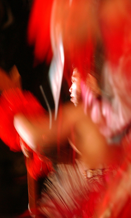 A dancer performs a Polynesian dance during the Sheraton Welcome Luau at the Royal Hawaiian Hotel in Waikiki, Hawaii, Tuesday evening, Dec. 20, 2005.&amp;#xA;&amp;#xA;David Calvert/Courtesy Nevada Media Services<br />