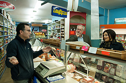 © Licensed to London News Pictures. 15/10/2015. Bristol, UK.  JEREMY CORBYN, leader of the Labour Party, visits Licata's Italian Delicatessan shop in Picton Street, Montpelier, Bristol, with Labour's Bristol West MP Thangam Debbonaire, following a rally for Labour Party members at the Trinity Centre in Bristol, to highlight and oppose the impact of the Government's changes to voter registration, expected to remove 1 million voters from the electoral roll by the end of the year. Photo credit : Simon Chapman/LNP