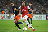 FOOTBALL - UEFA CHAMPIONS LEAGUE 2012/2013 - GROUP STAGE - GROUP B - MONTPELLIER HSC v ARSENAL - 18/09/2012 - PHOTO SYLVAIN THOMAS / DPPI - LUKAS PODOLSKI (ARS) / JAMEL SAIHI (MHSC)