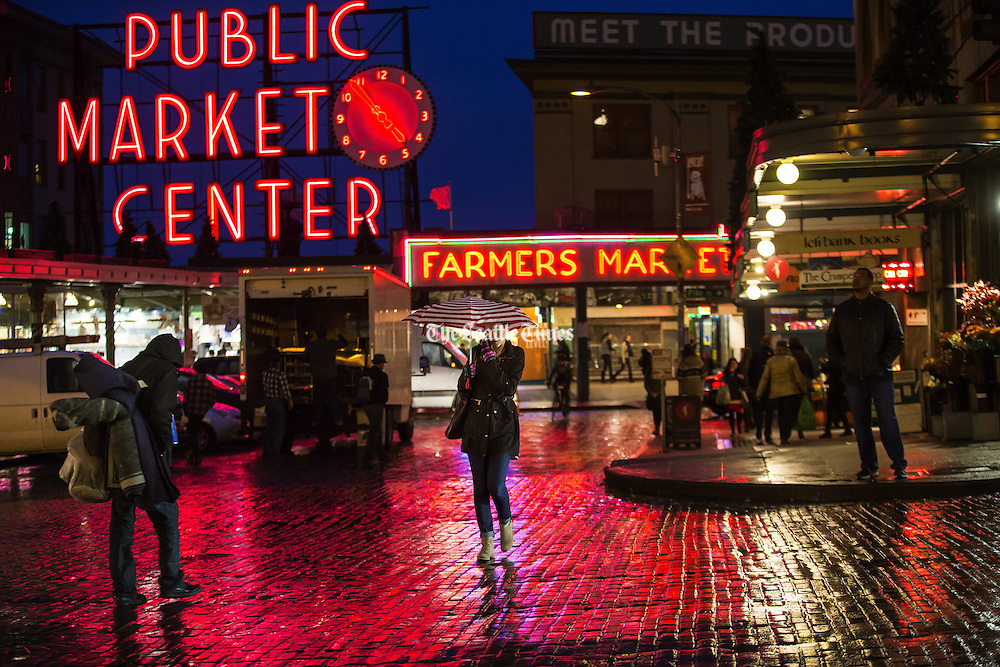 A wet and gloomy commute greeted workaday Seattle for the evening commute home, shown here at the Pike Place Market downtown. <br /> Dean Rutz / The Seattle Times