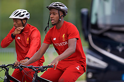 ROTTACH-EGERN, GERMANY - Friday, July 28, 2017: Liverpool's Divock Origi cycles back to the team hotel after a training session at FC Rottach-Egern on day three of the preseason training camp in Germany. (Pic by David Rawcliffe/Propaganda)