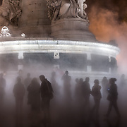 FRANCE. Île-de-France, Paris. October 6th, 2013. Visitors explore the artwork of Fujiko Nakaya who has combined art, science and technology to create a 'Fog Square' during the Nuit Blanche event at the Place de la Republique. This year marks the 12th edition of the Nuit Blanche festival. The city turns into a harvest of art, music and theatrical events.