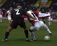 Picture: Raymond Field<br /><br /><br />Woking F.C v Kidderminster Harriers FA second round<br /><br />06/12/2003<br /><br />Adie Smith hold Raphael Nade back