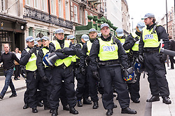 J11 protest.<br /> The Metropolitan Police TSG prepare to protect Fortnum and Mason's on Piccadilly during the J11 protest in central London by the StopG8 anti-capitalist movement,<br /> London, United Kingdom<br /> Tuesday, 11th June 2013<br /> Picture by Mark  Chappell / i-Images