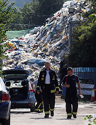 © Licensed to London News Pictures. 25/07/2014. Orpington. London firefighters are today, 25th June 2014, at the Waste4fuel recycling plant in Orpington, Kent. They have been on the site since yesterday morning (June 24) tackling several deep-seated pockets of fire. Two engines were also called to the site on Tuesday morning (July 23) to deal with two small pockets of fire. Byline:Grant Falvey/LNP