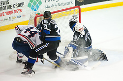 March 11 2016: Bentley Falcons goalie Gabe Antoni (1) makes a save shot by Robert Morris Colonials forward Brandon Denham (44) during the first period in game one of the Atlantic Hockey quarterfinals series between the Bentley Falcons and the Robert Morris Colonials at the 84 Lumber Arena in Neville Island, Pennsylvania (Photo by Justin Berl)