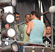 18.AUGUST.2013. LONDON<br /> <br /> MARVIN HUMES AND BEN FODEN WATCH THE SATURDAYS PERFORMING LIVE AT V FESTIVAL, HYLANDS PARK, CHELMSFORD, ON SUNDAY AUGUST 18, 2013.<br /> <br /> BYLINE: EDBIMAGEARCHIVE.CO.UK<br /> <br /> *THIS IMAGE IS STRICTLY FOR UK NEWSPAPERS AND MAGAZINES ONLY*<br /> *FOR WORLD WIDE SALES AND WEB USE PLEASE CONTACT EDBIMAGEARCHIVE - 0208 954 5968*
