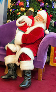 Nov. 21, 2012 - Garden City, New York, U.S. - Santa Claus gets a visit from PATRICK HERR, 3 1/2, from Hempstead, at Roosevelt Field shopping mall in Long Island. Mom JULIANA CARREON and ISMAEL CARREON took him to visit the jolly man at Roosevelt Field, one of the 10 largest shopping malls in the United States of America, and on the site where aviator Charles Lindbergh began his historic solo transatlantic flight to Paris in 1927.