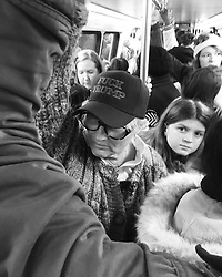 """Fuck Trump"" as women, families, and girls wait patiently on a crowded Washington Metro train on the way to the Women's March on Washington, D.C."