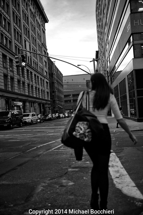 NEW YORK, NY - October 28:  A woman crosses Hudson St. on October 28, 2014 in NEW YORK, NY.  (Photo by Michael Bocchieri/Bocchieri Archive)