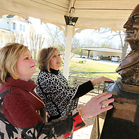 Ann Godwin Monaghan and Phyllis Livingston, look over the bronze bust of John Allen that was unveiled by Monaghan and her brother Chauncey Godwin Wednesday morning at the John Allen Fish Hatchery in Tupelo. The Godwin family of Tupelo commissioned Mississippi Artist William Beckwith to create the bust in memory of Mrs. Louise Godwin.