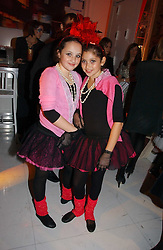 Left to right, PHOEBE SAATCHI and SCARLETT LESLEY at a party to celebrate the launch of DKNY Kids and Halloween in aid of CLIC Sargent and RX Art held at DKNY, 27 Old Bond Street, London on 31st October 2006.<br />