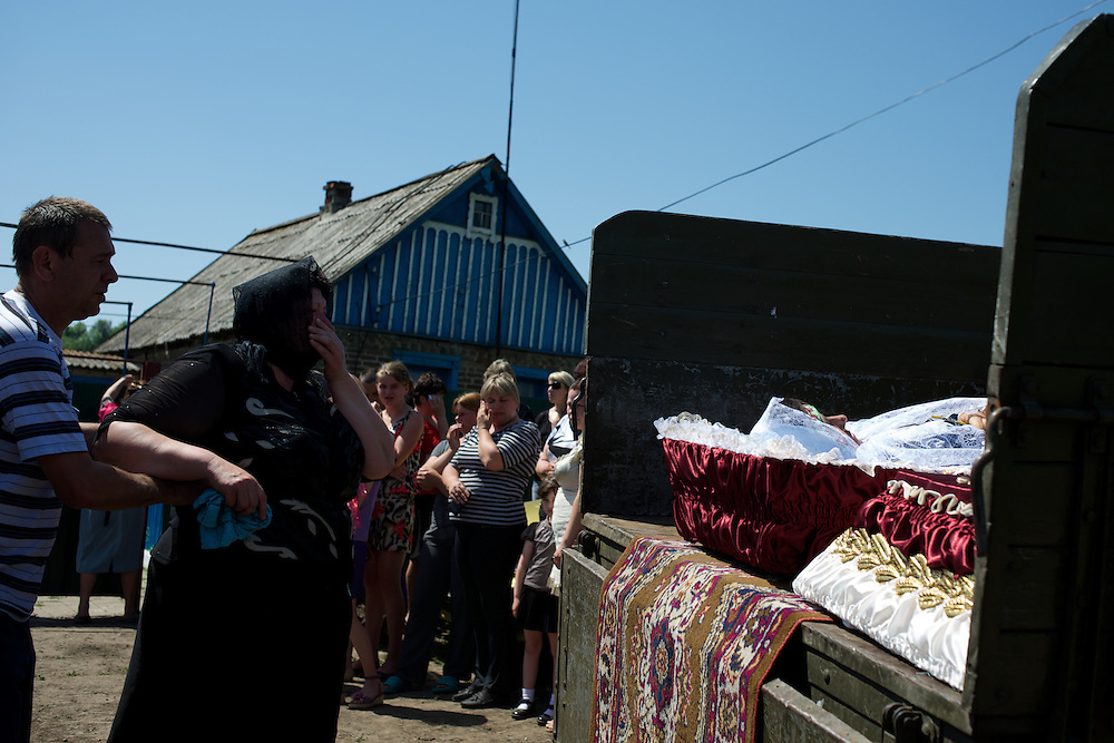 Family and friends attend the funeral of Elena Ott, a 42 year old mother of two killed by gunfire near an Ukrainian military checkpoint on the evening of the 14th of May, as she was driving home with her youngest son.