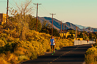 Man running on a path along Tramway Boulevard, Albuquerque, New Mexico USA