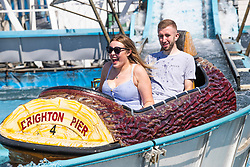 © Licensed to London News Pictures. 01/08/2020. Brighton, UK. Members of the public enjoy the attractions on the Brighton Palace Pier as sunny weather hits the seaside resort. Photo credit: Hugo Michiels/LNP