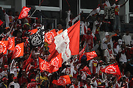 CAPE TOWN, SOUTH AFRICA - 11 FEBRUARY 2011, Ajax Cape Town fans celebrate during the Absa Premiership match between Santos and Ajax Cape Town held at Athlone Stadium in Cape Town, South Africa..Photo by: Shaun Roy/Sportzpics