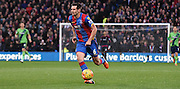 Scott Dann in control on the ball during the Barclays Premier League match between Crystal Palace and Southampton at Selhurst Park, London, England on 12 December 2015. Photo by Michael Hulf.