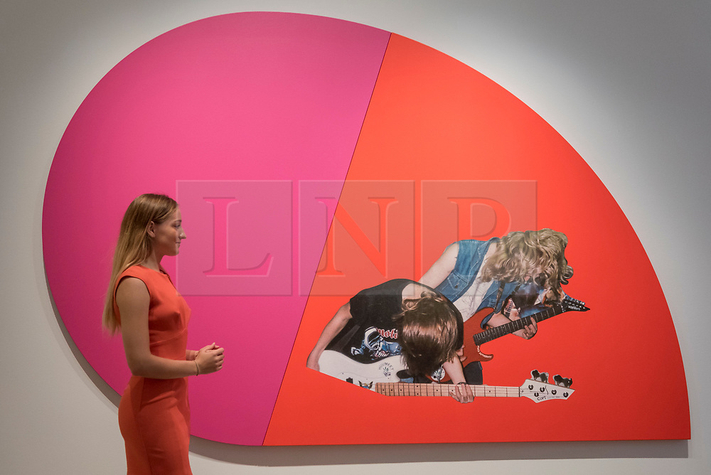 """© Licensed to London News Pictures. 08/09/2017. London, UK. A staff member views """"Riff Lash"""", 2010, by Steven Shearer (Est. GBP50-70k), at a preview of 'Shake It Up', a collection of contemporary artworks from the personal collection of celebrity photographer Mario Testino. Proceeds from the upcoming auction of the collection at Sotheby's in London will benefit Museo Mate in Lima, Peru.  Photo credit : Stephen Chung/LNP"""