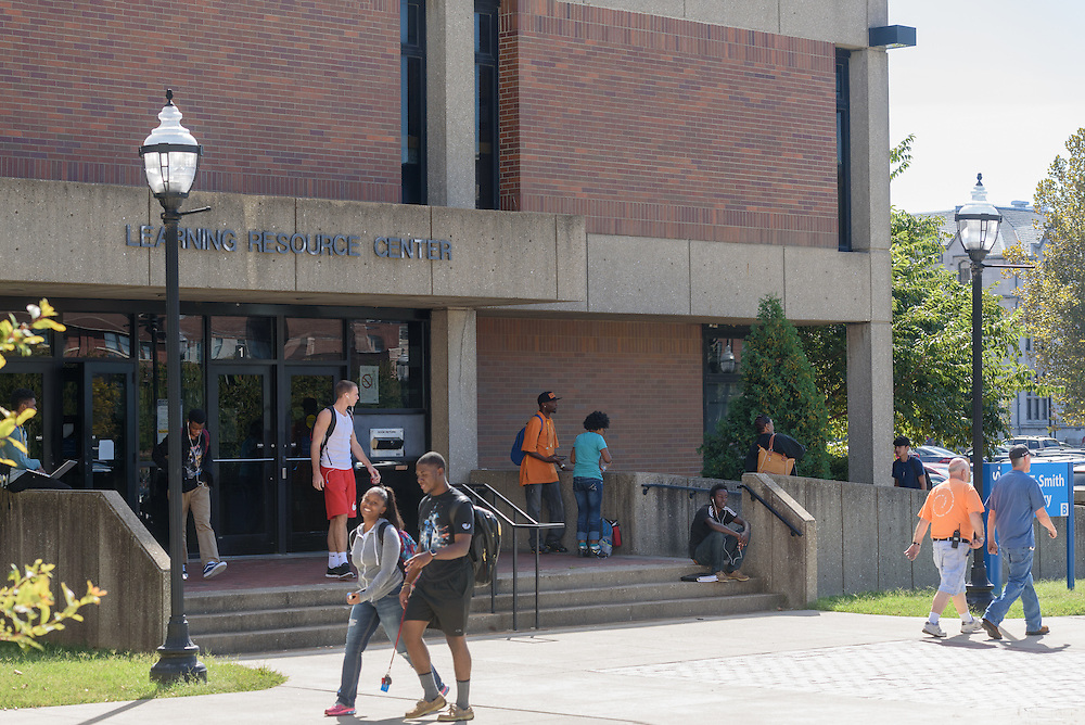 Students walk past the John T. Smith Library on the Jefferson Community & Technical College downtown campus Thursday, Sept. 22, 2016 in Louisville, Ky. (Photo by Brian Bohannon)