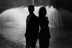 Silhouette of Couple Standing by Fountain