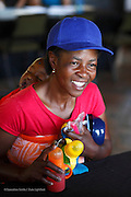 027, Siyabonga Gwebu, 17 Months,Male, UCL, before with mother Athalia during patient announcement as she hears that Siyabonga is on the schedule. Bundu Lodge during Operation Smile South Africa&rsquo;s 2015 mission to Mbombela. South Africa.<br /> <br /> (Operation Smile Photo - Zute Lightfoot)