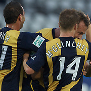 Dylan Macallister (right) is congratulated by team mate after scoring the Mariners second goal goal during the Central Coast Mariners V Brisbane Roar A-League match at Bluetongue Stadium, Gosford, Australia, 19 December 2009. Photo Tim Clayton